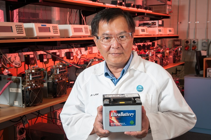 Dr Lan Lam holding the UltraBattery in a lab.