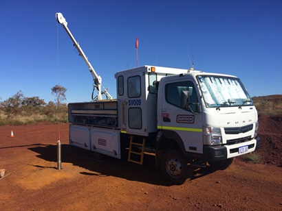 Truck next to exploration drilling rig