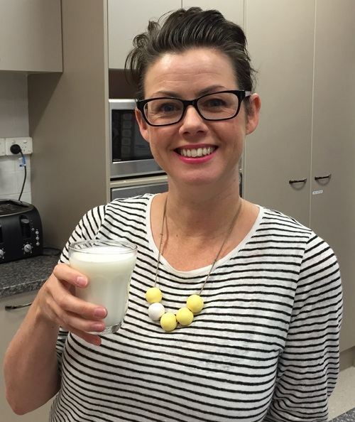 Dr Sinead Golley holds a glass of milk.