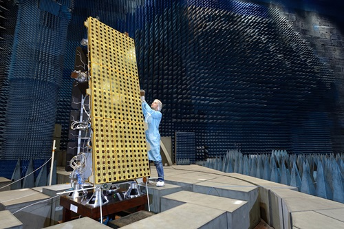 A technician works on the NovaSAR satellite in clean room.