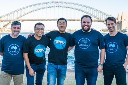 Five people standing in front of the Sydney Harbour Bridge in CSIRO t-shirts