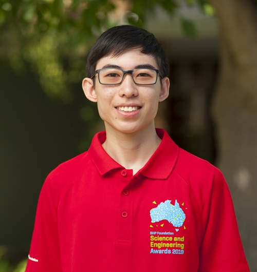 Josiah Cheng wearing a red BHP Foundation Science and Engineering Awards 2019 shirt.