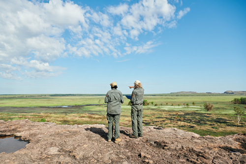 Two park rangers with backs to camera