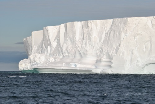 View across the water to the edge of an ice shelf.