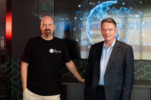 Bruce Thompson and Mats Henrikson standing in front of a digital display.