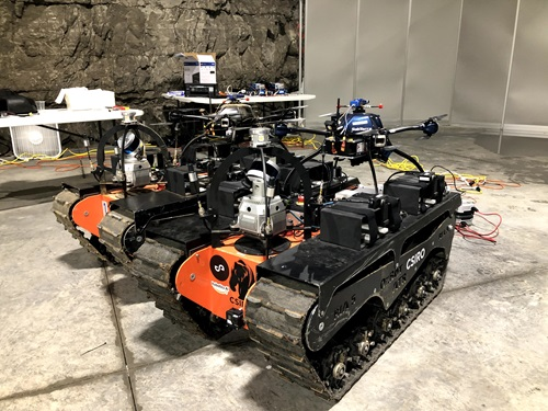 Two of team CSIRO's Data61's all terrain tracked robots, each with aerial robots mounted on top