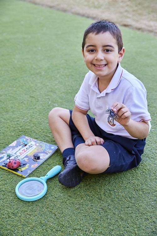 Raphael Da Rosa, Year 1 student at Cannon Hill Anglican College is fascinated with spiders wasps featured in AmAZed!