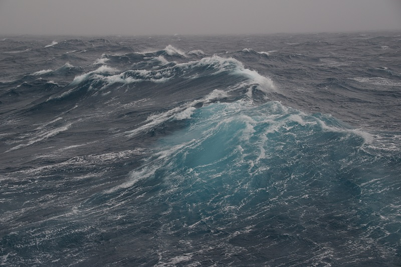 Open ocean wave with white crests
