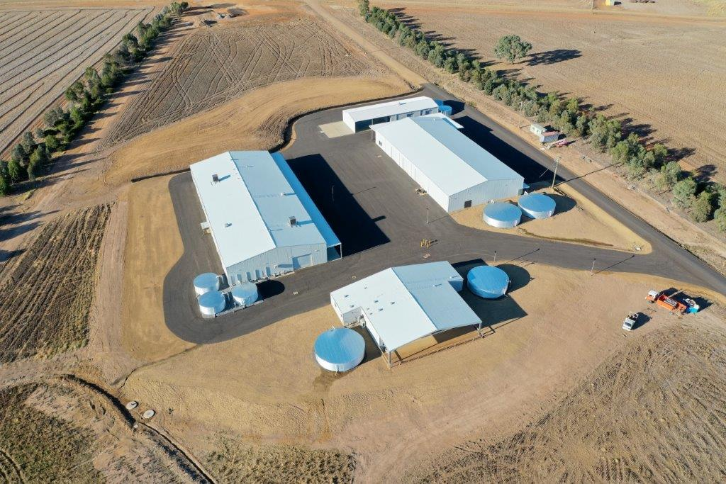 Aerial view of 3 large workshops and water tanks