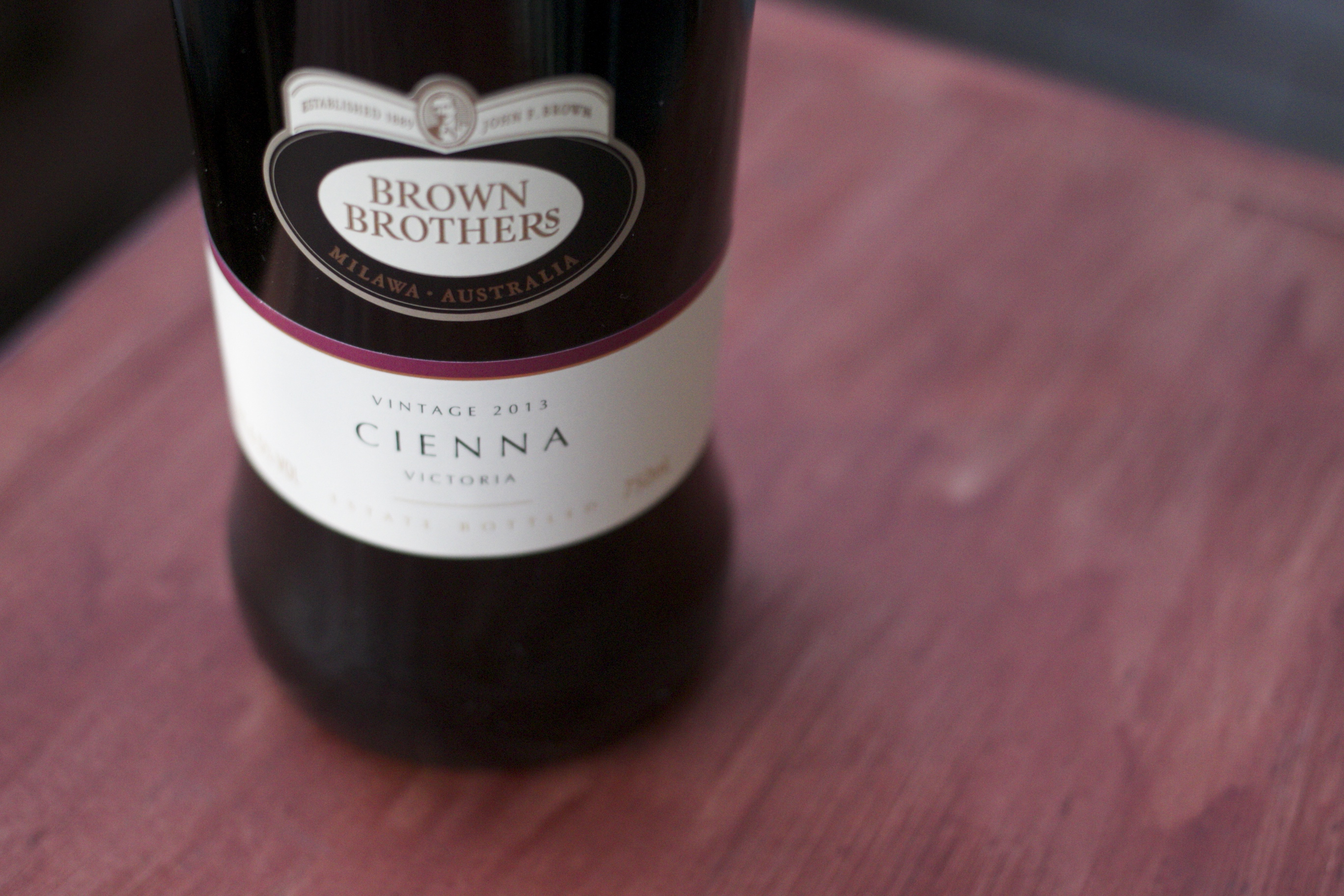 medium close shot of wine bottle with label - Brown Brothers, Cienna