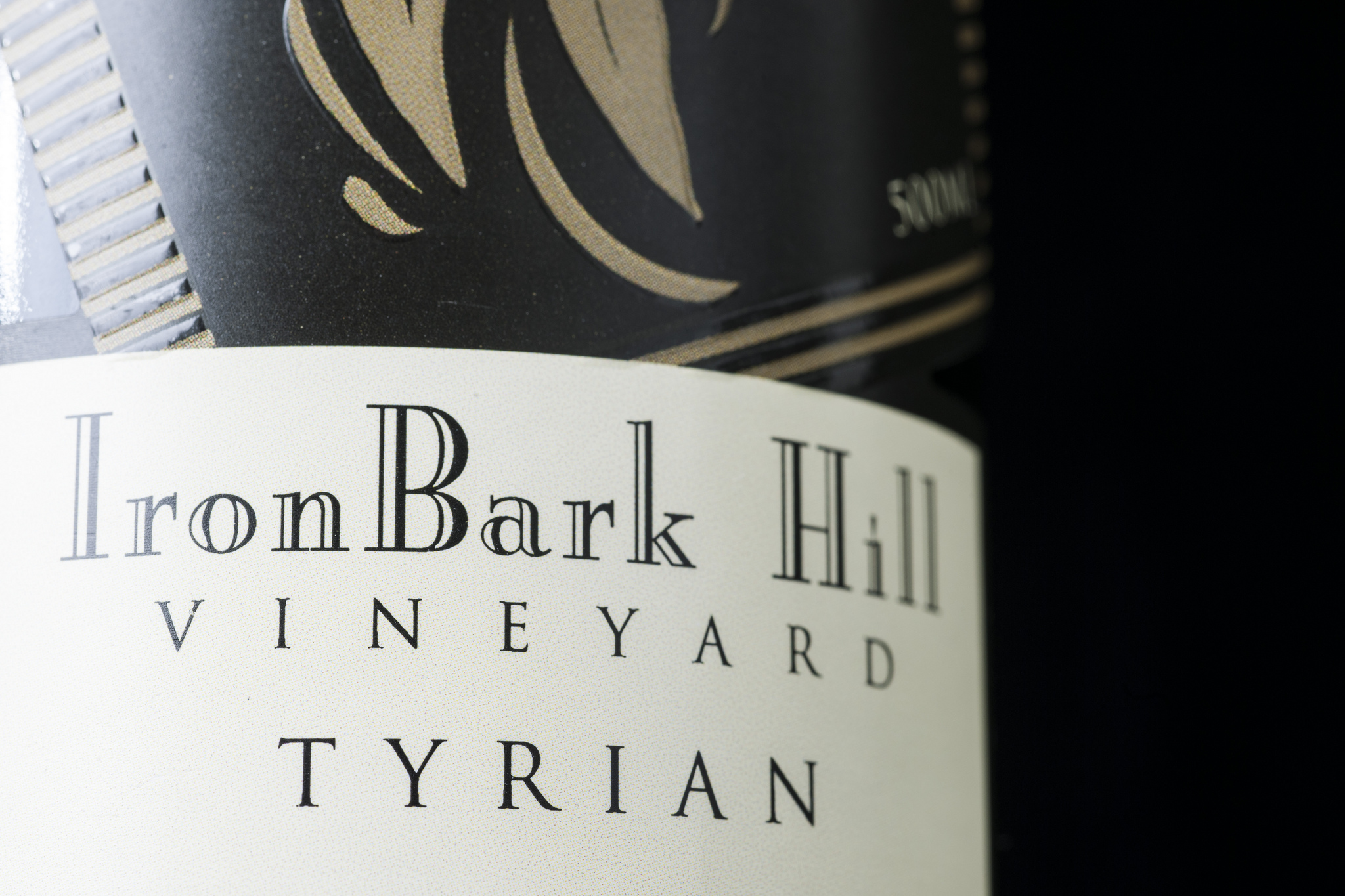 close shot of label on wine bottle - text reads: Ironbark Hill Vineyard, Tyrian.