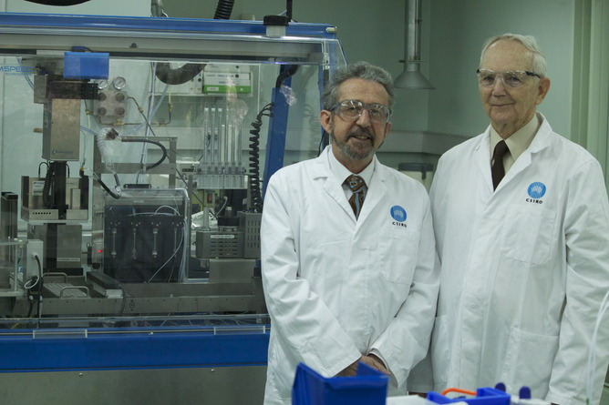 Dr Ezio Rizzardo and Professor David Solomon standing in the lab.
