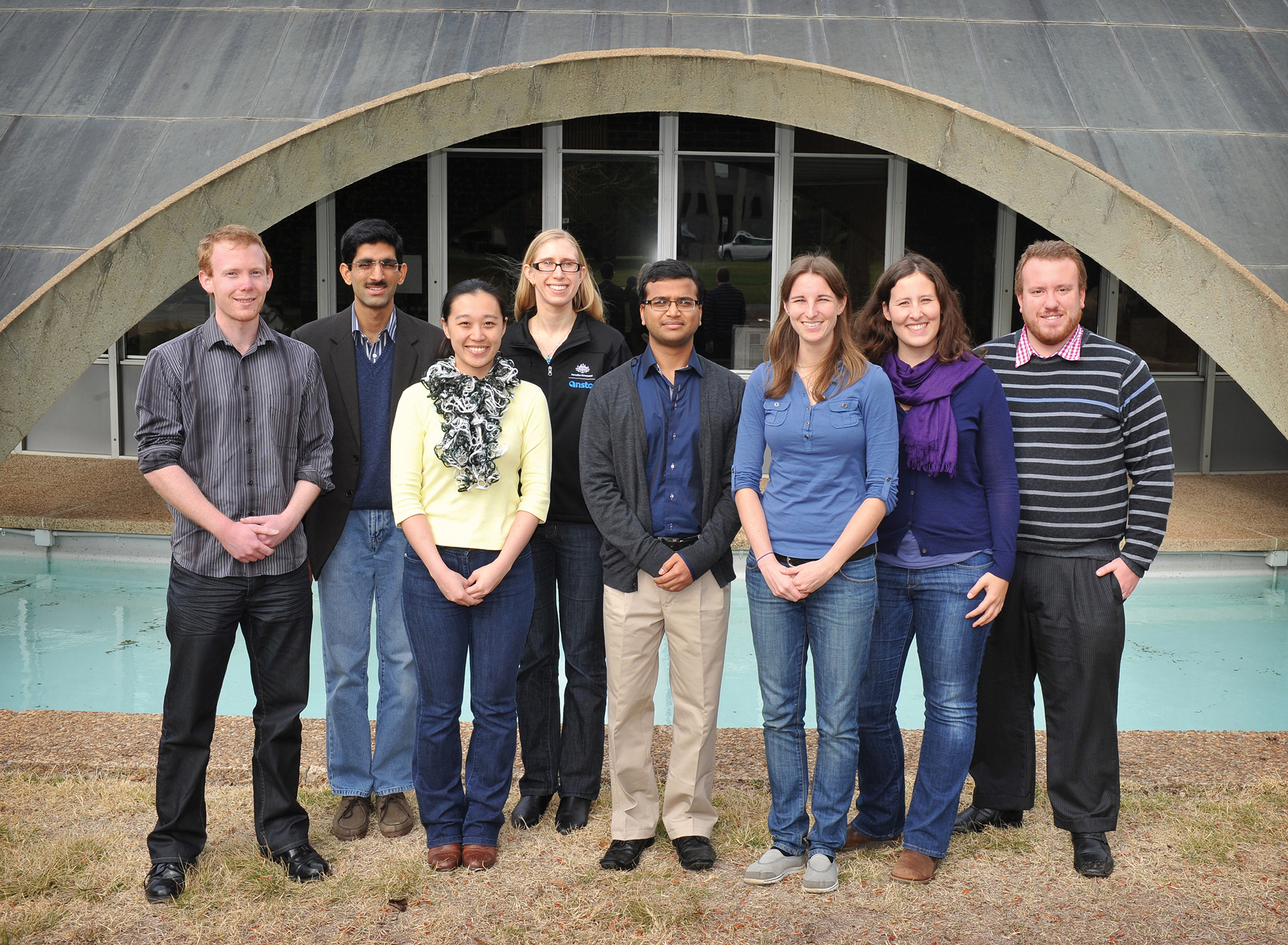 The eight 2013 recipients of the SIEF-Australian Academy of Science Fellowships to the Lindau Nobel Laureate Meetings stand in front of the Shine Dome in Canberra.