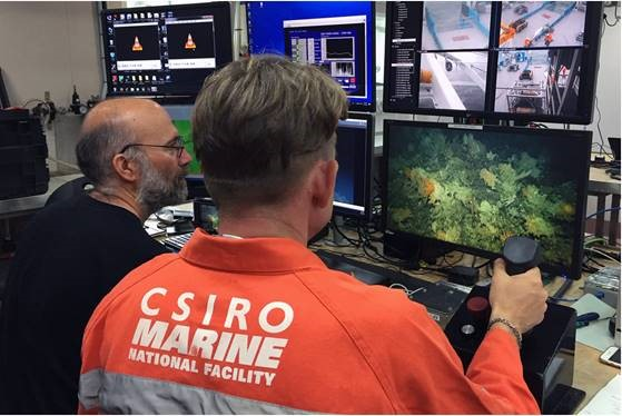 CSIRO staff member Nick Mortimer sitting to the left of 'pilot' Karl Forcey, who seen is flying the deep-tow camera over a seamount.