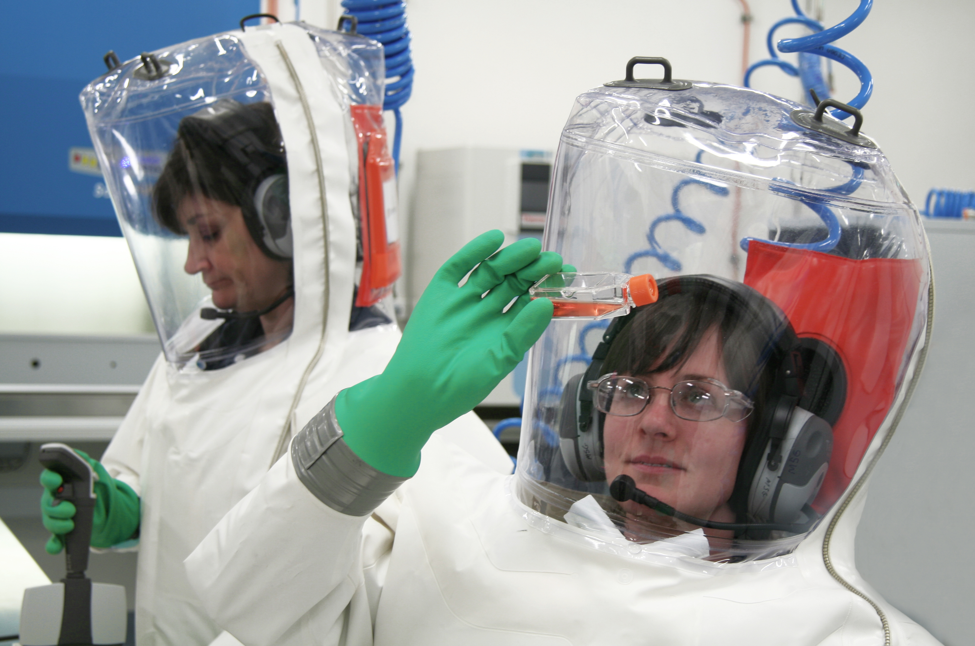 Scientists wearing fully encapsulated suits with their own air supply.