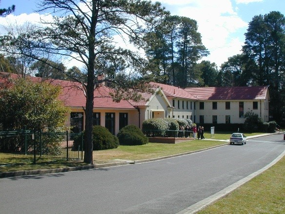 Building at Yarralumla site in background with road running across front of the building in the foreground.