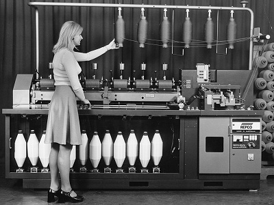 Woman standing in front of CSIRO's patented Repco self-twist spinning machine
