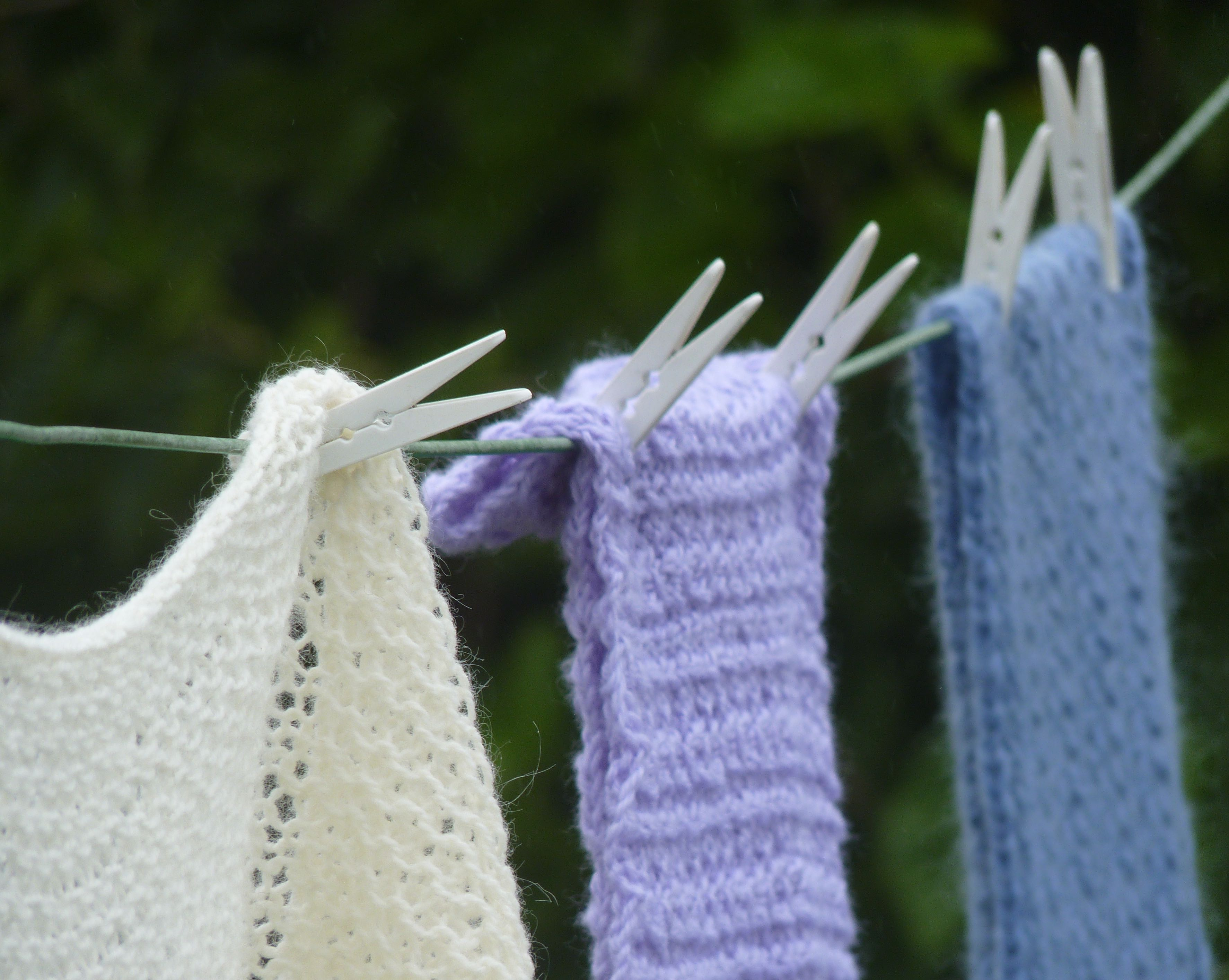 Woolen scarves hanging on a clothes line