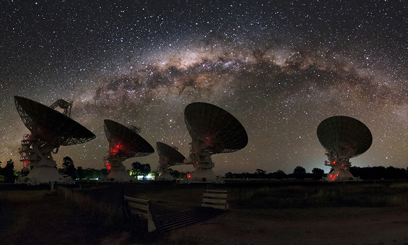 Five telescopes of the Australia Telescope Compact Array under the Milky Way.