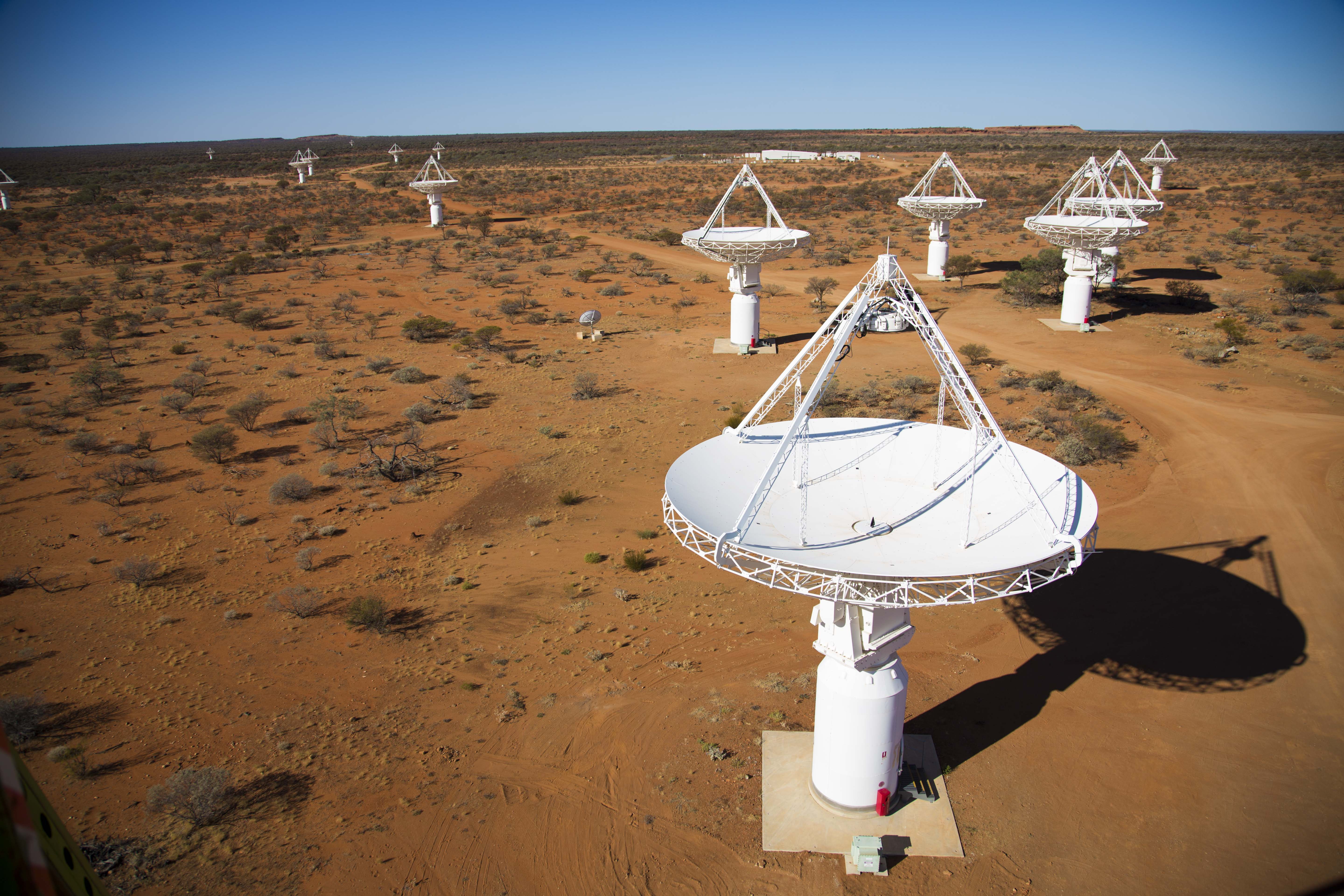 White Radio-astronomy antennas clustered in the red Australian desert