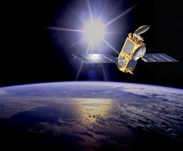 A black background with the bright sun at centre top of the image, a space satellite to the side, and the Earth below.
