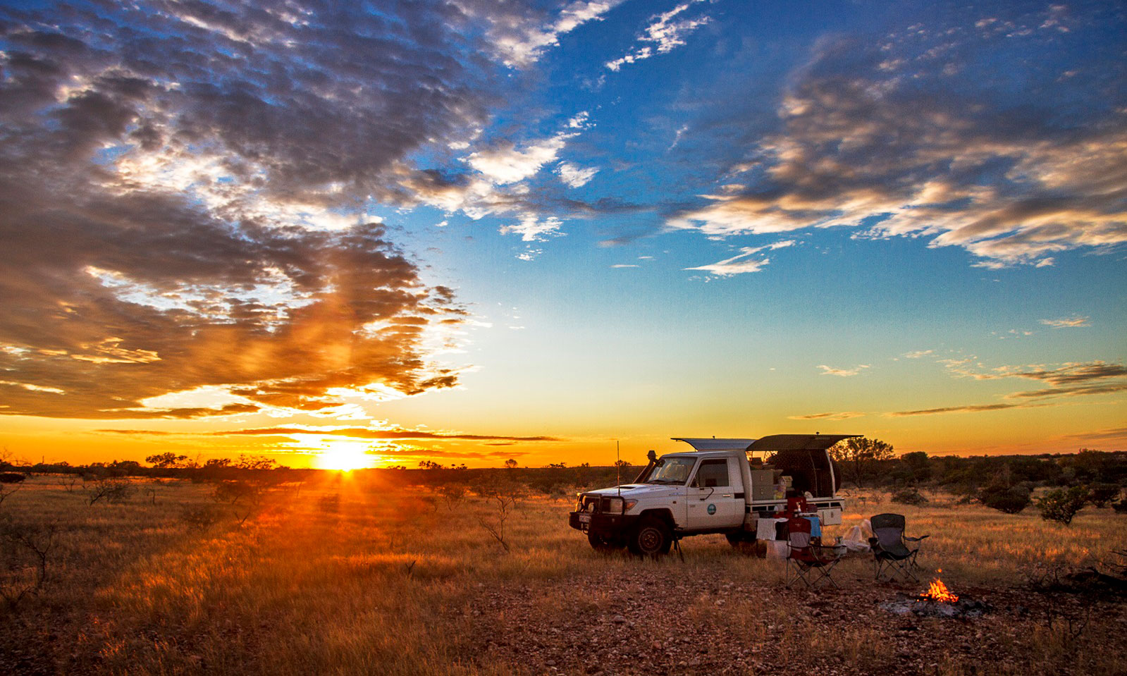 A sunset with a CSIRO ute in the foreground