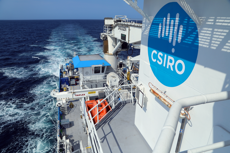 A boat with the CSIRO logo moving through the water