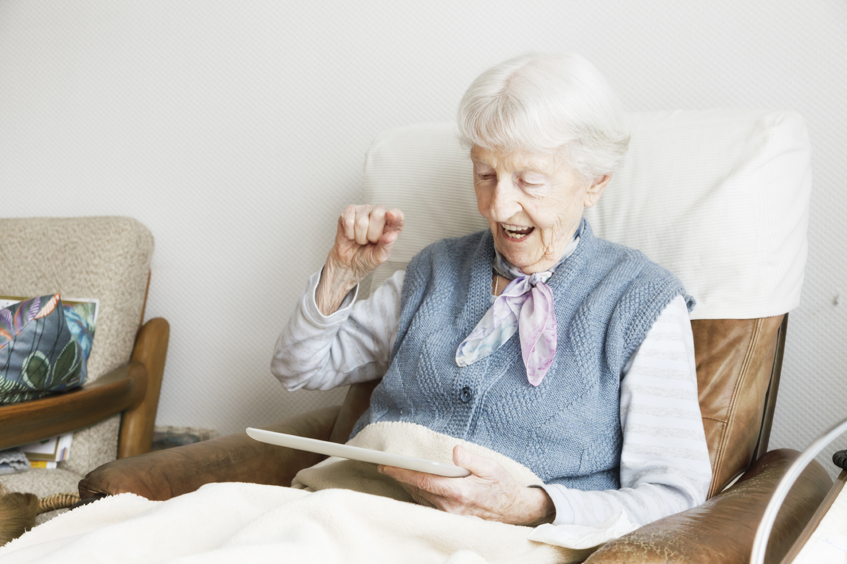 Elderly woman using an e-tablet