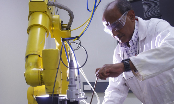 researcher working on a machine