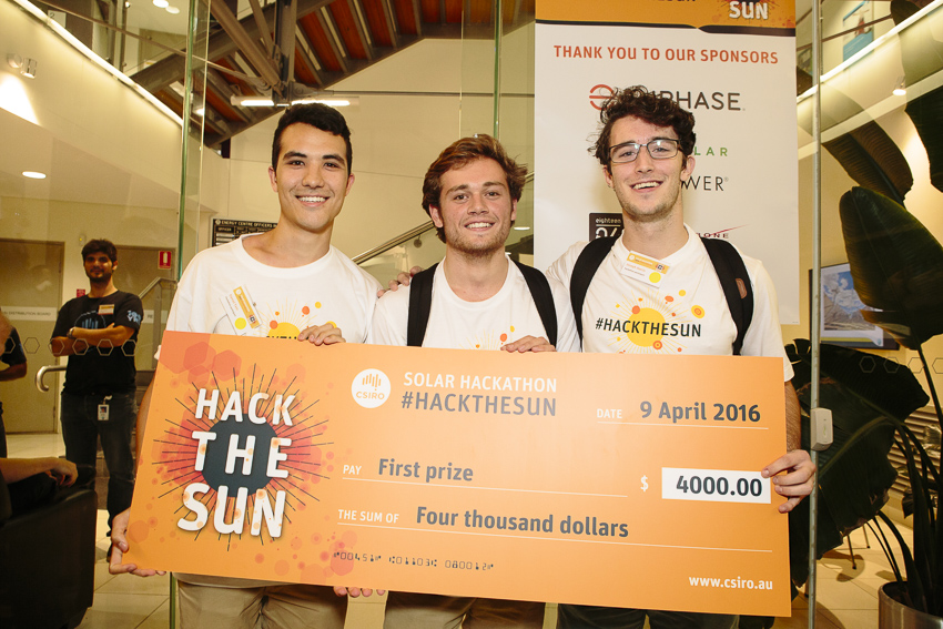 Thre young men, the winners of the CSIRO Solar Hackathon hold up their winning cheque