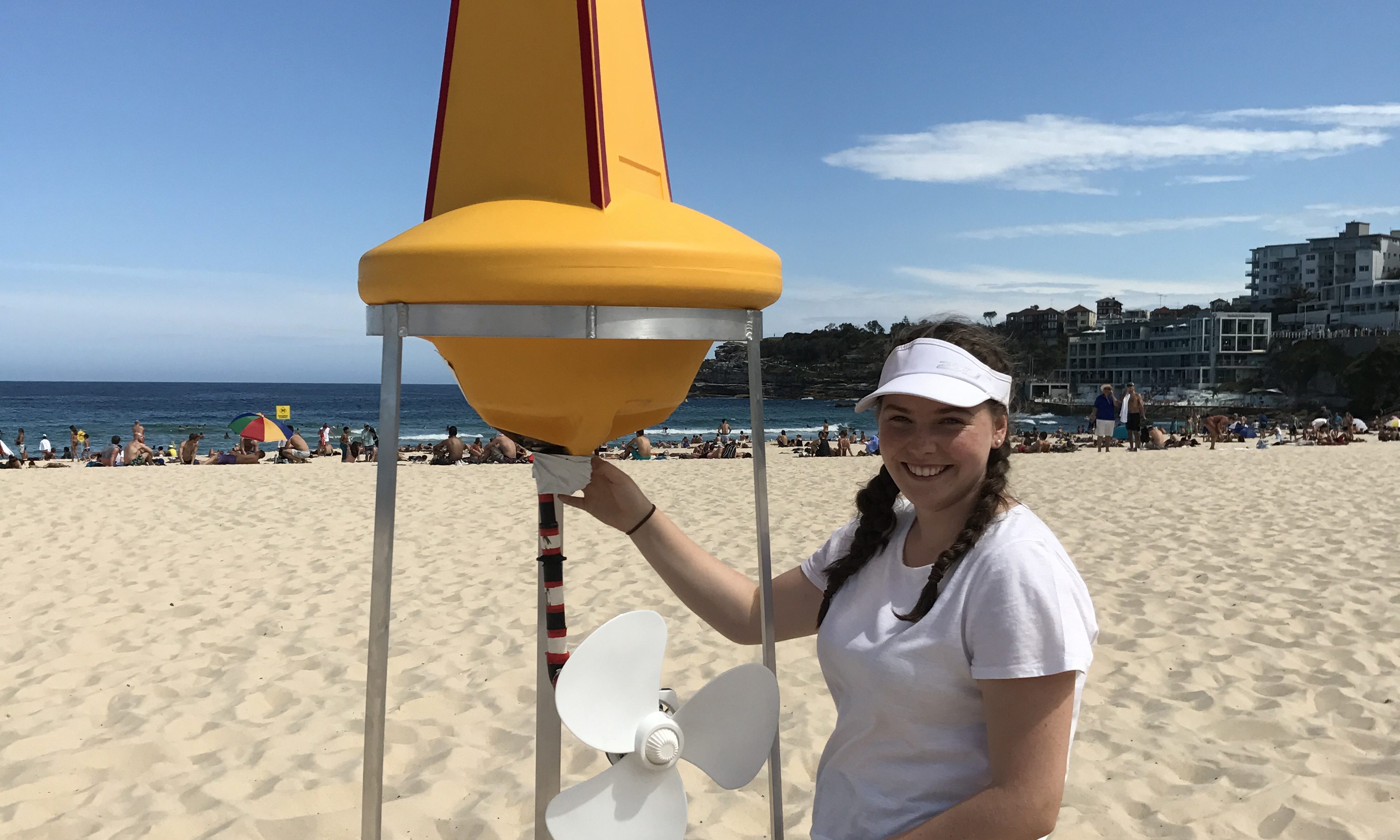 2017 BHP Billiton Science and Engineering Awards finalist Maddison King at the beach with her invention
