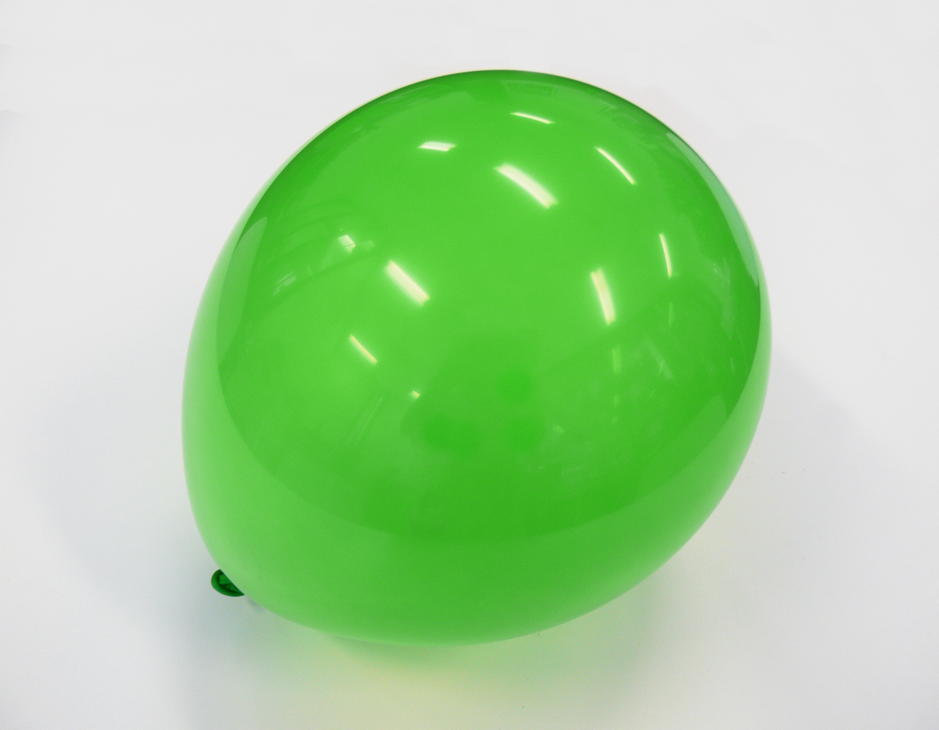 inflated green balloon