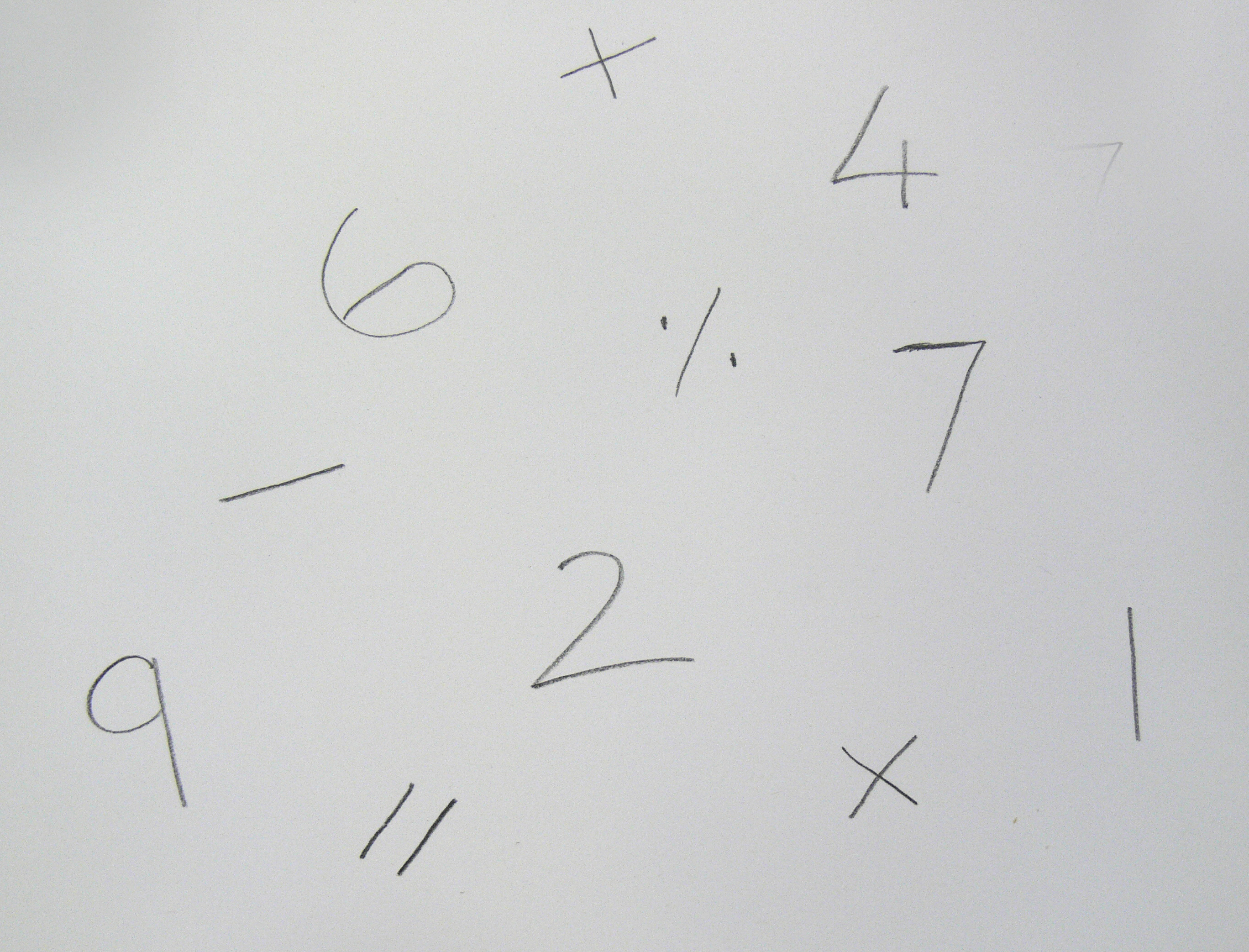 numbers 9, 6, 7, 4, 2, and 1 randomly written on paper with mathematical symbols
