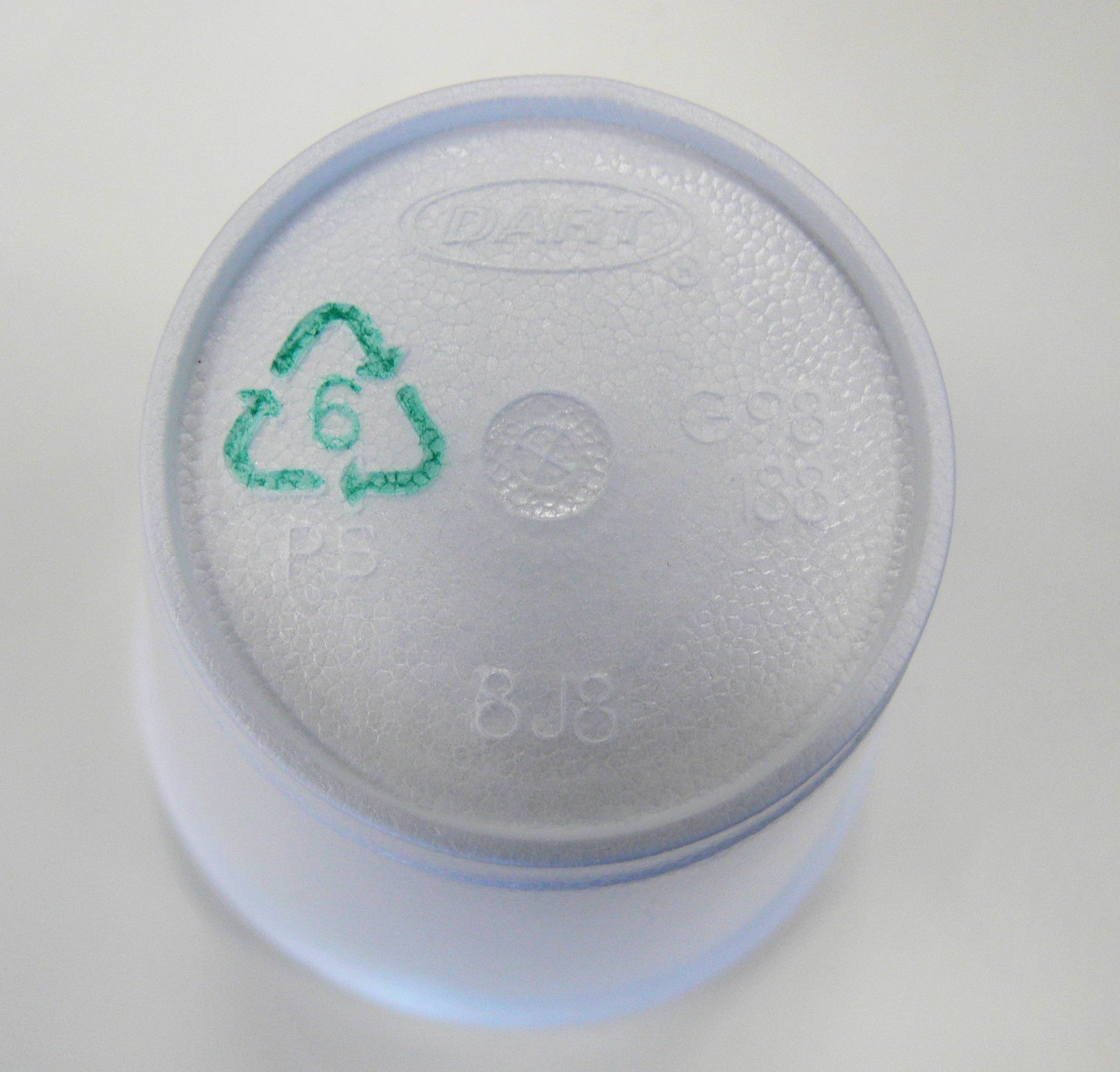 plastic container with recycle symbol triangle of arrows with number 6 inside triangle
