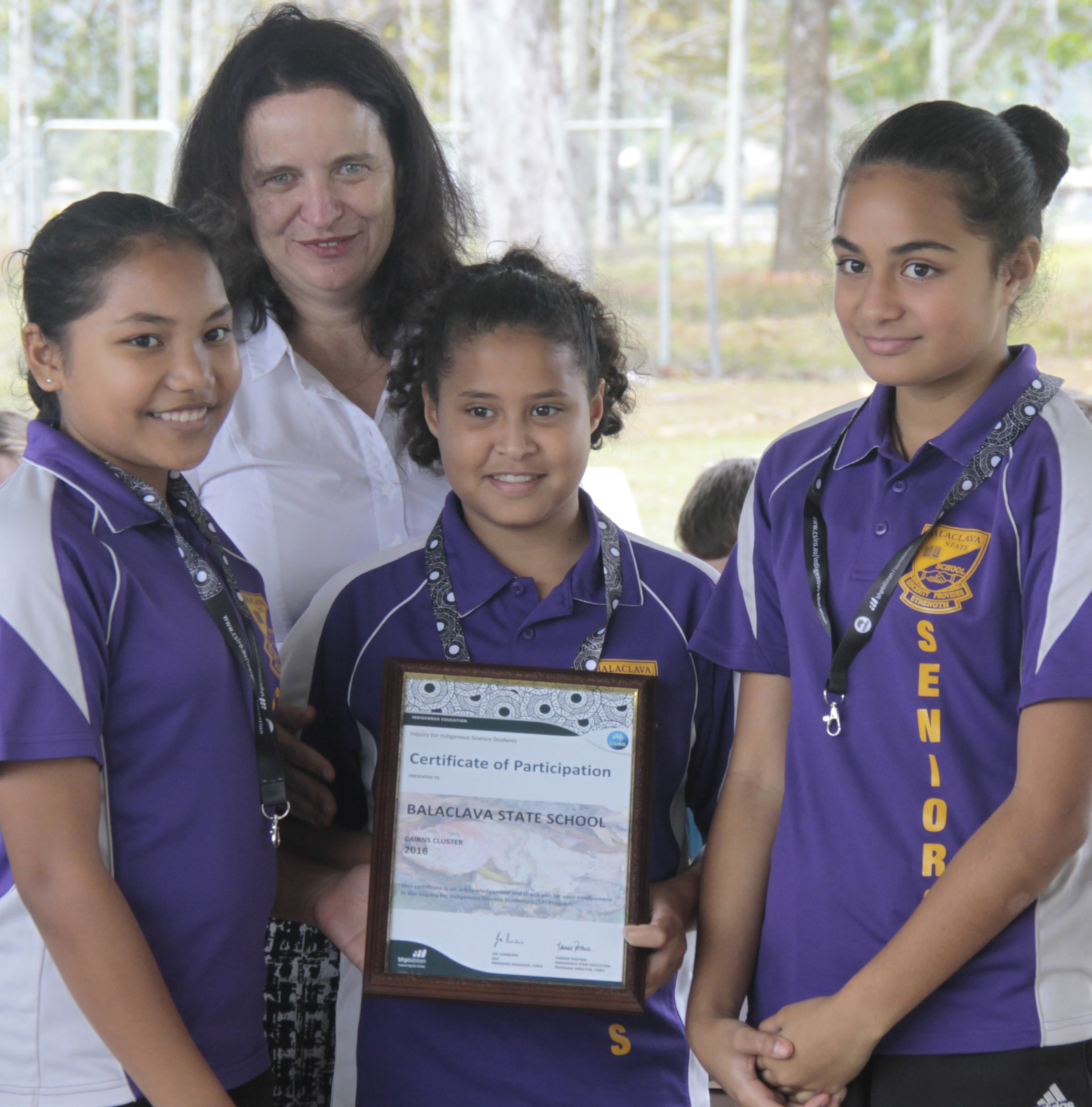 Image of Therese Postma, Indigenous STEM Education Program Director, presenting Balaclava State School's certificate of participation in the Inquiry for Indigenous Science Students program.