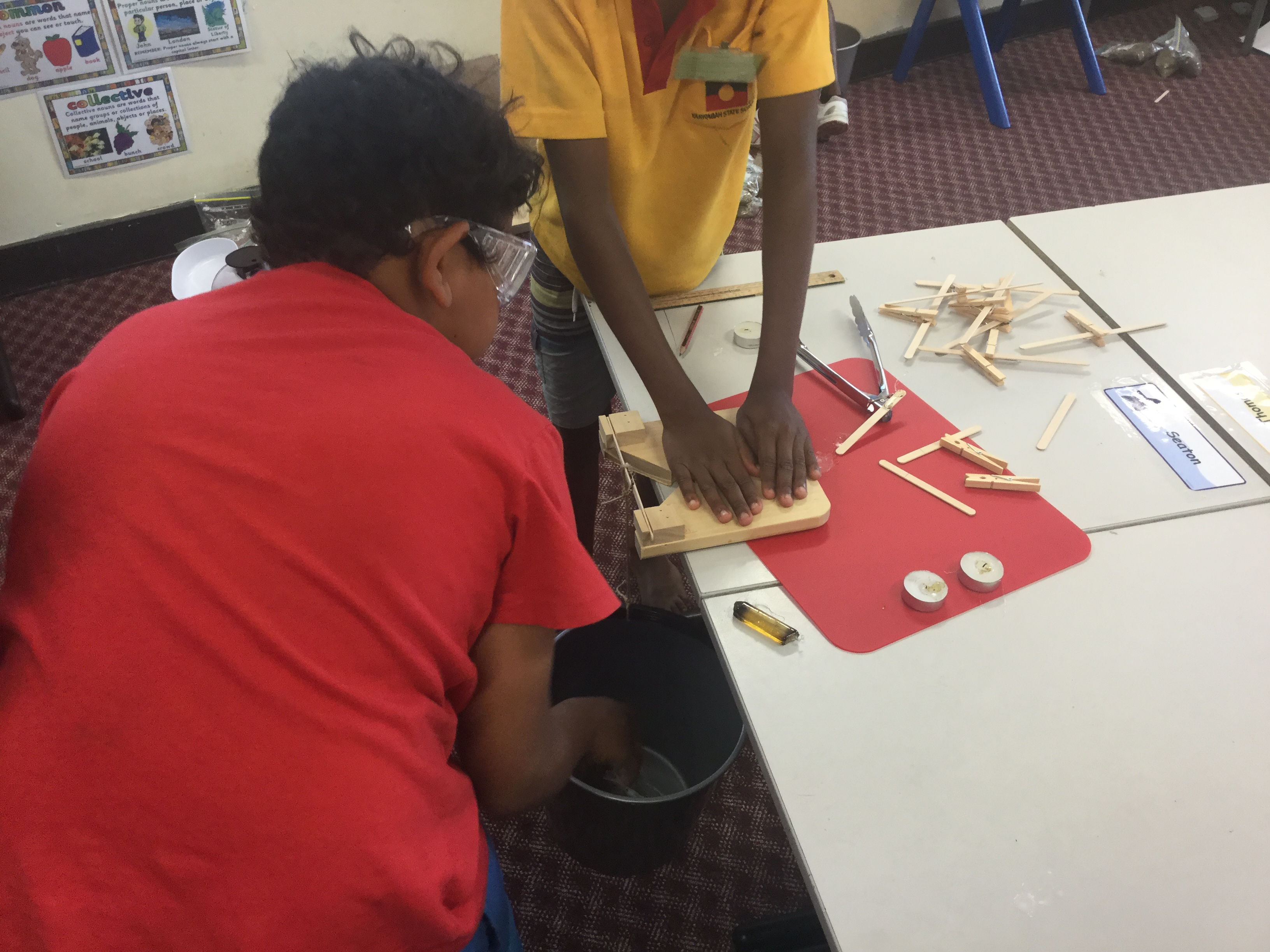 Image of students conducting the Sticking Together Scaffolded Inquiry