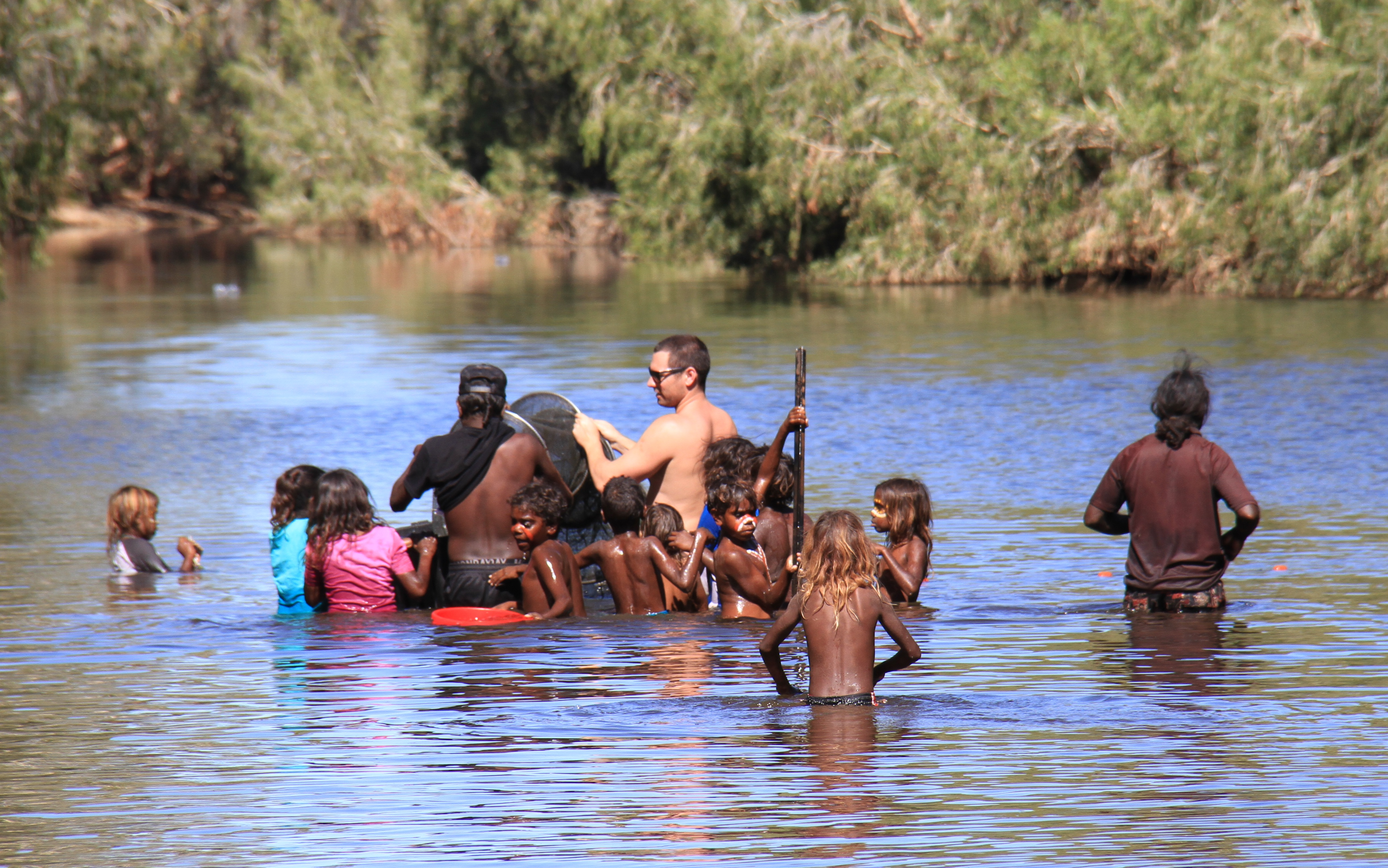 Warralong Fish Monitoring Project - Students in the Coongan River checking Fyke nets.