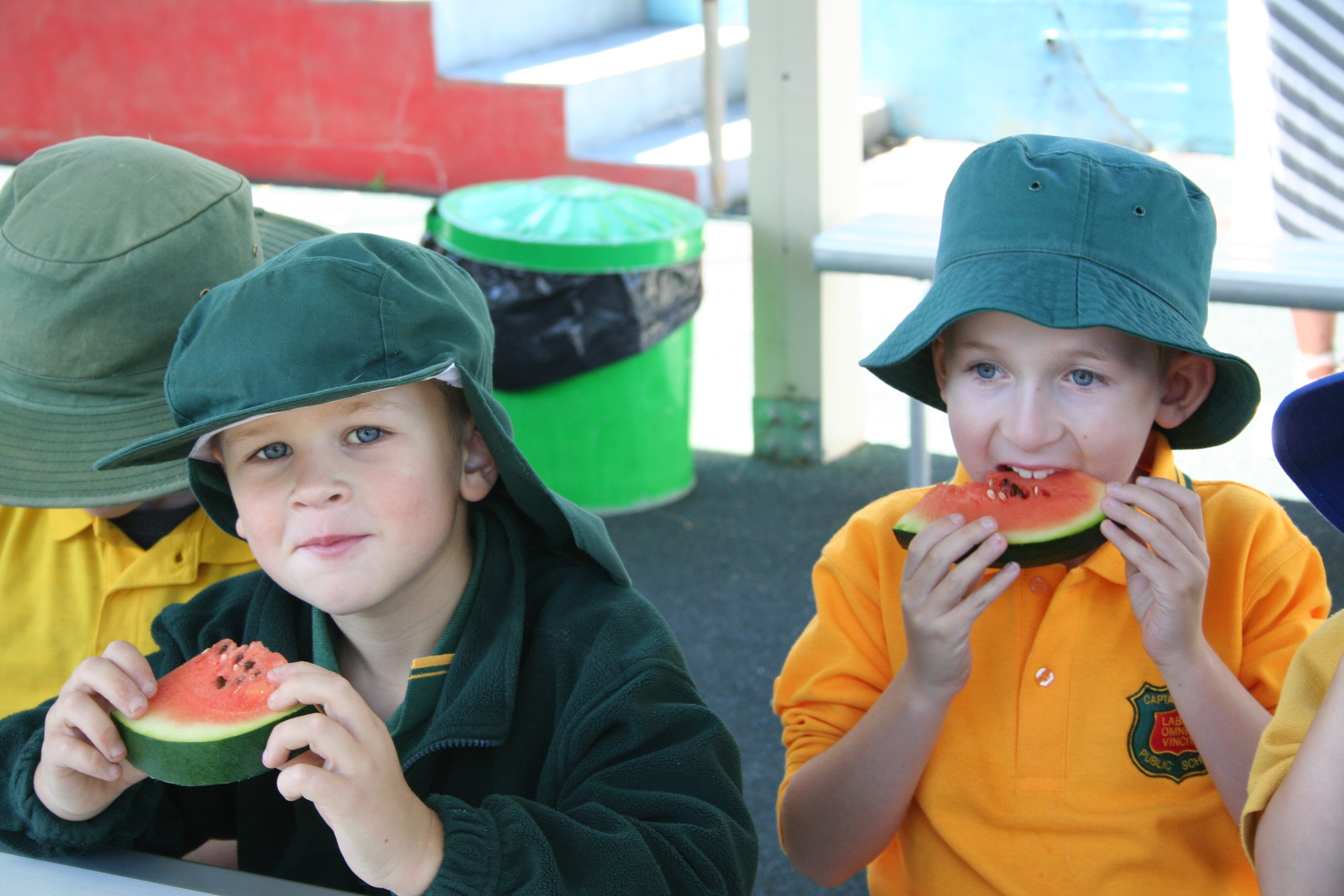 Students enjoying some slices of watermelon