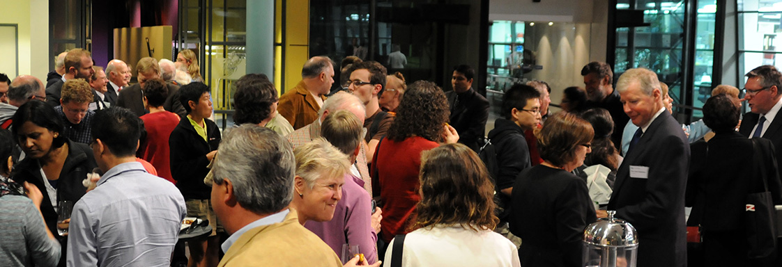 People socialising in the foyer before the Malcolm McIntosh Lecture