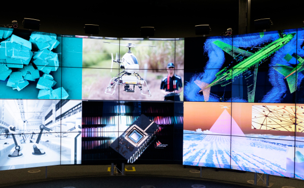 Image of a large screen showing graphical depictions of research into agriculture, sensors, the environment and imaging.