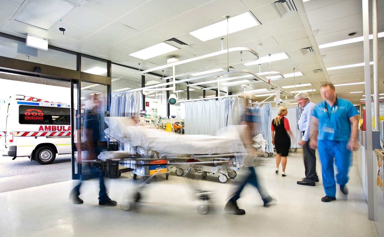 Blurred image of people moving quickly around a hospital.