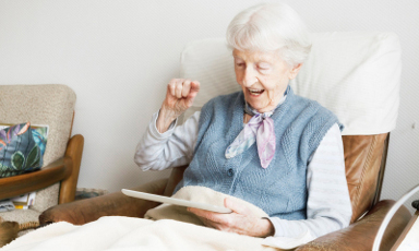 an elderly lady on an tablet device