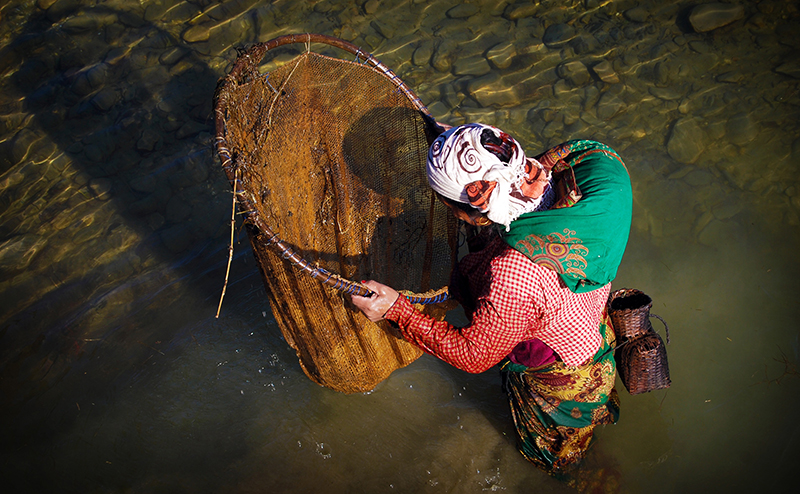 Woman looking in fishing net