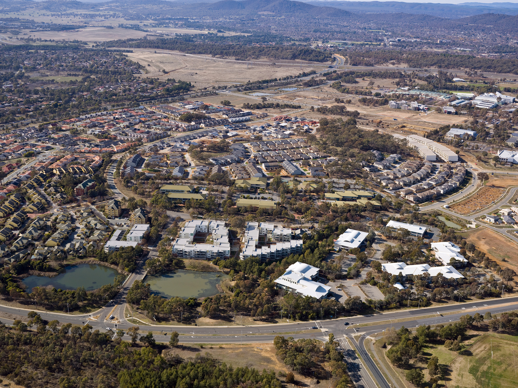 Aerial photograph showing urban landscape including homes, businesses, roads and parklands