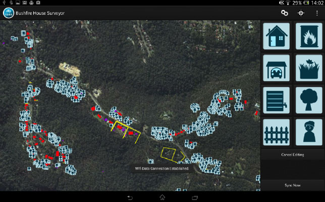 A topographic map image on a smart device showing houses among bushland with various digital markings added to the map