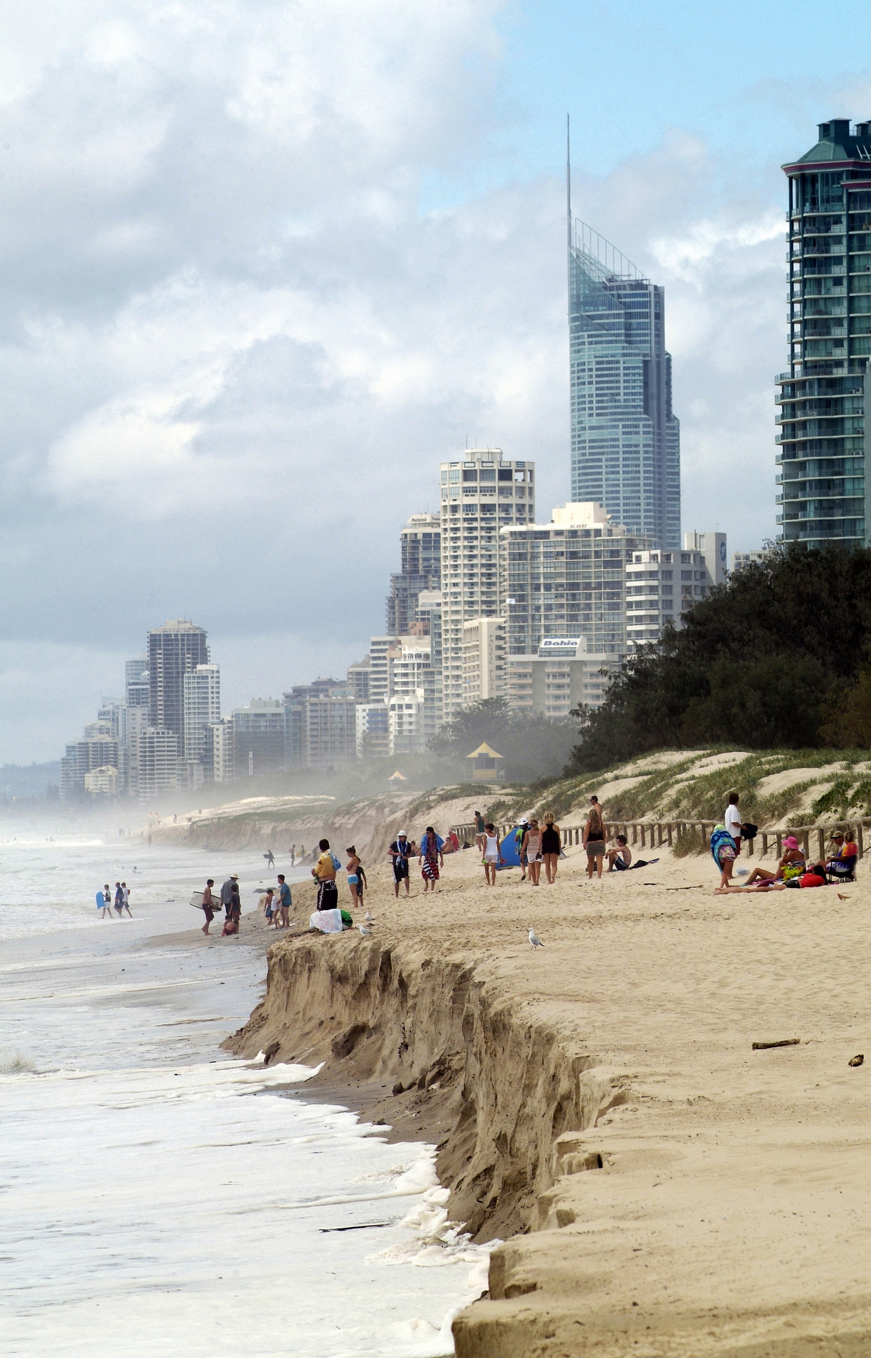 Gold Coast beach after a king tide, with major sand erosion in the foreground and high-rise properties in the background