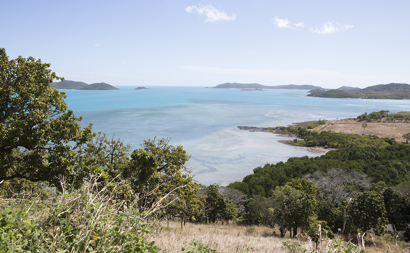 View from an island out over blue waters with other islands in the distance