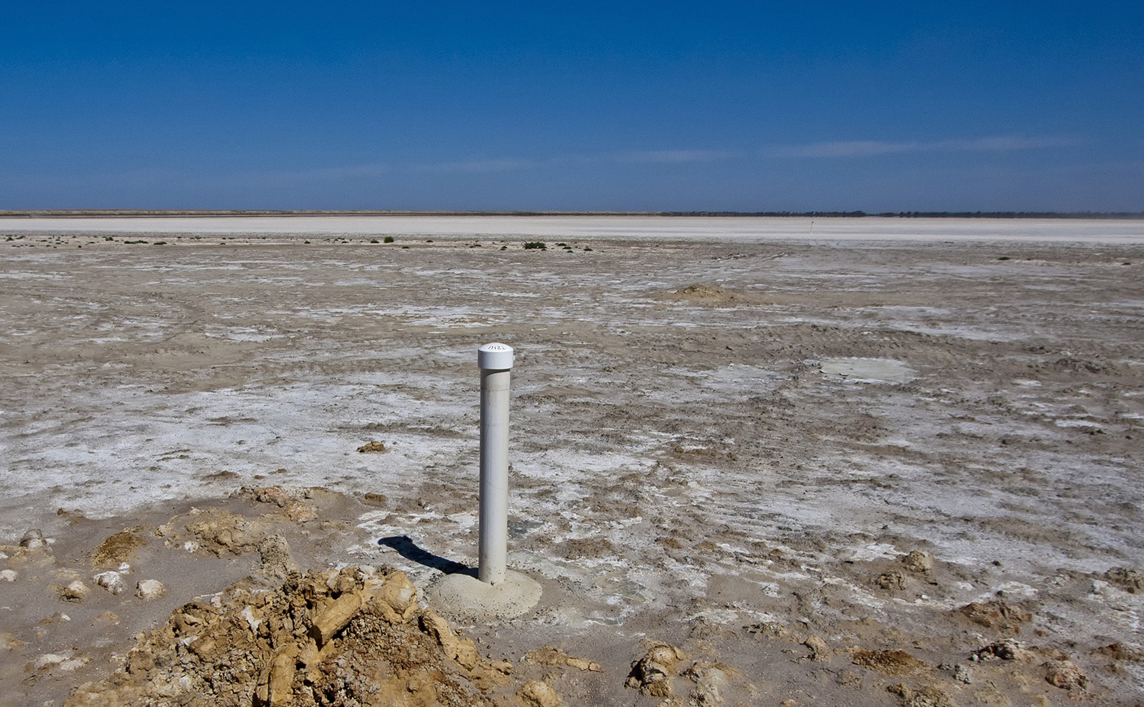 Barren landscape with salt visible on surface of soil