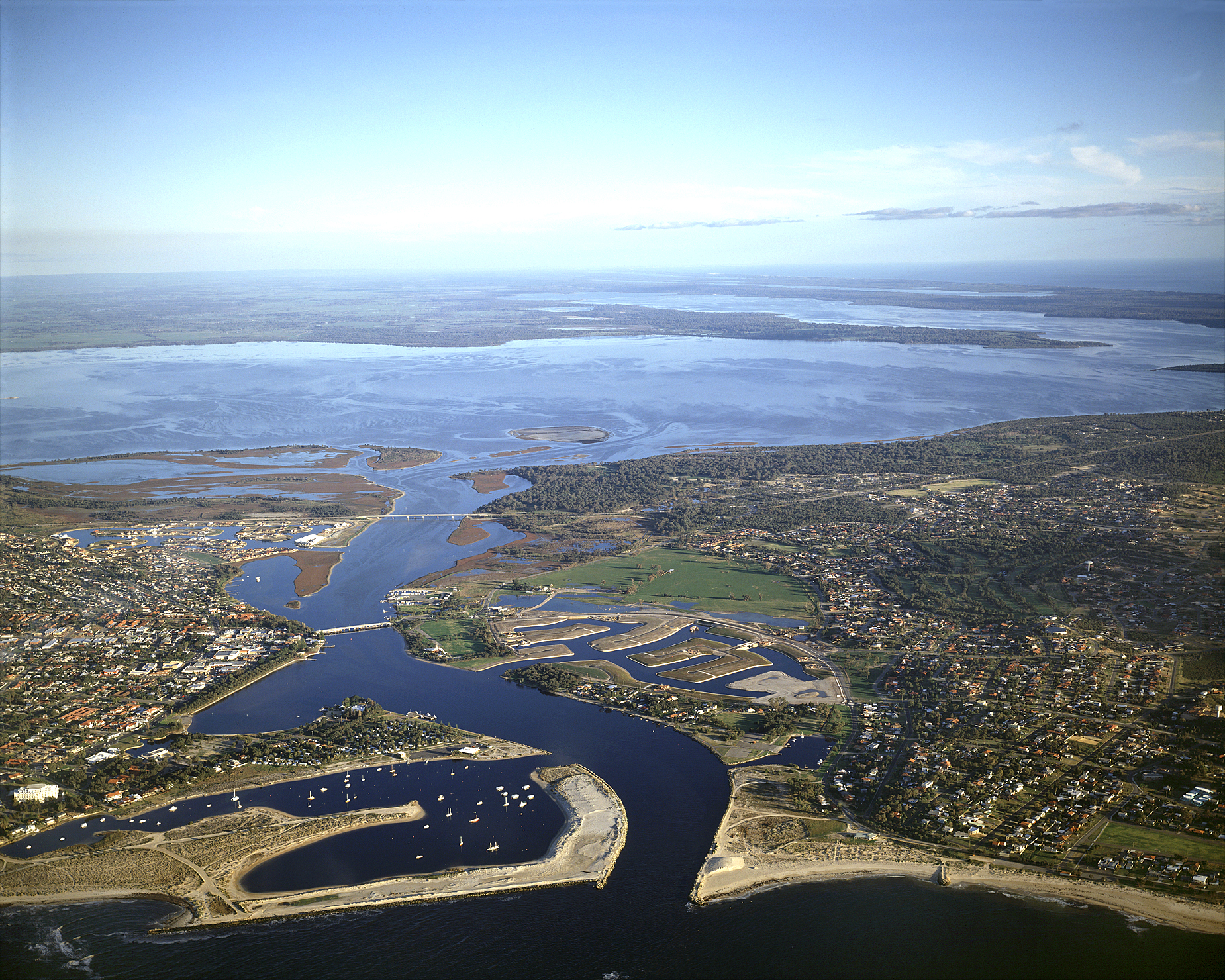 Overhead shot of Mandurah estuary - water way stretching through housing developments