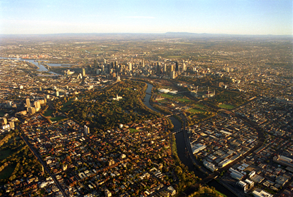 Aerial photo of Melbourne CBD, Yarra River, urban parkland and suburbs.